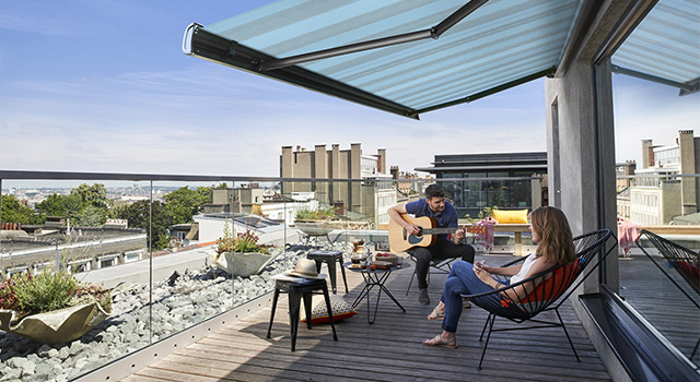 An Orchestra folding-arm awning offers ideal protection from the sun