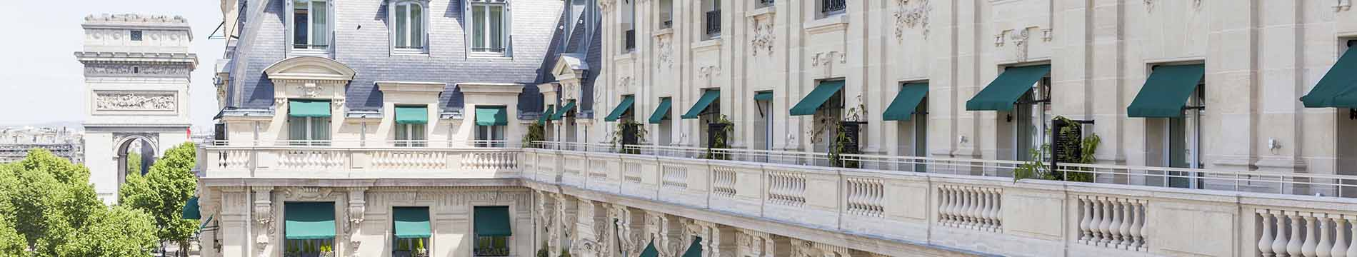 Dickson fabrics fitted to folding-arm awnings on a Paris building