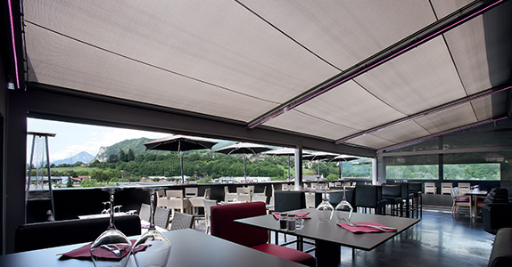 A Dickson pergola side-awning fabric in a French restaurant